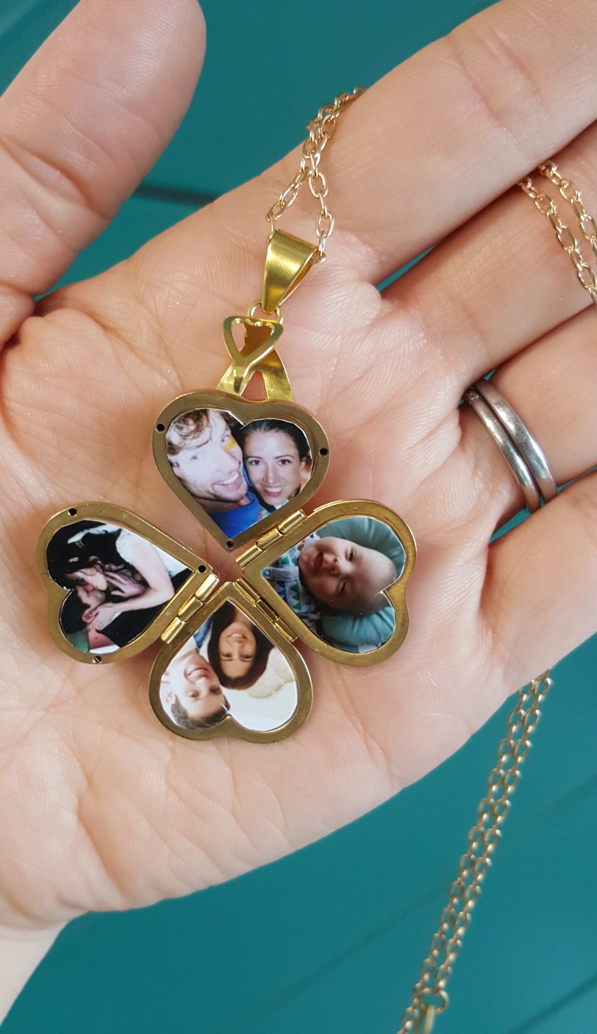 Heart shape photo locket with four pictures each side with gold chain